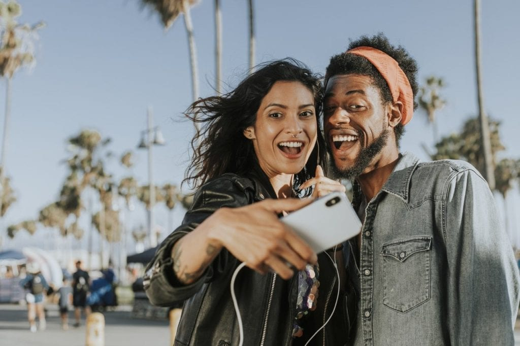 woman taking a selfie with a man