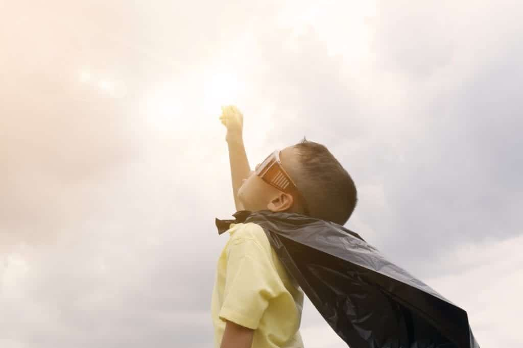 Child wearing a cape