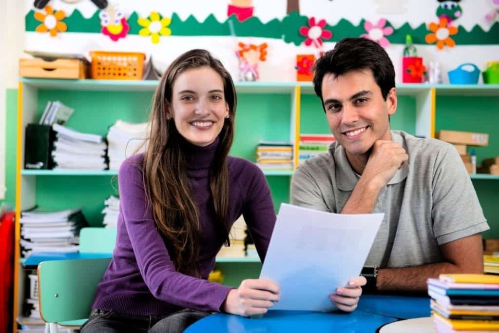 Young couple at parent teacher conference