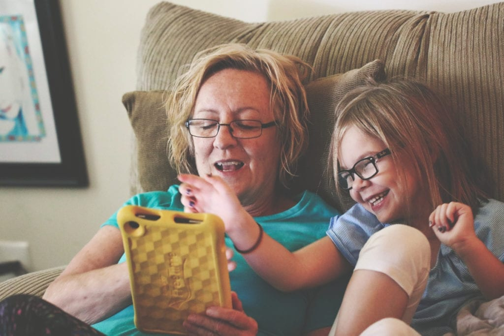 Gandmother and Granddaughter playing on a tablet
