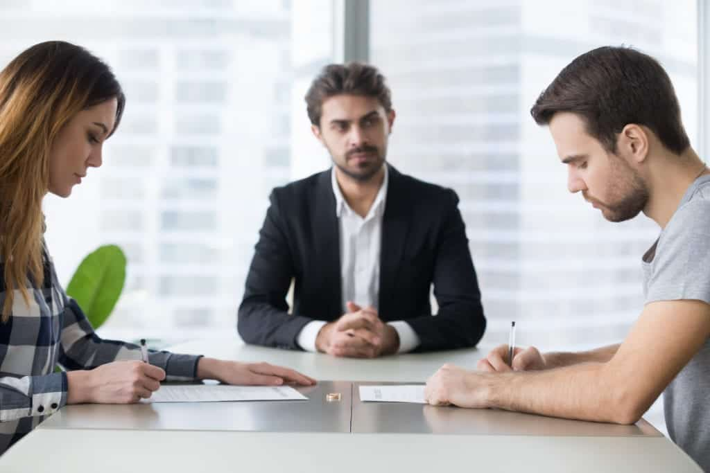 Two people meeting with a mediator